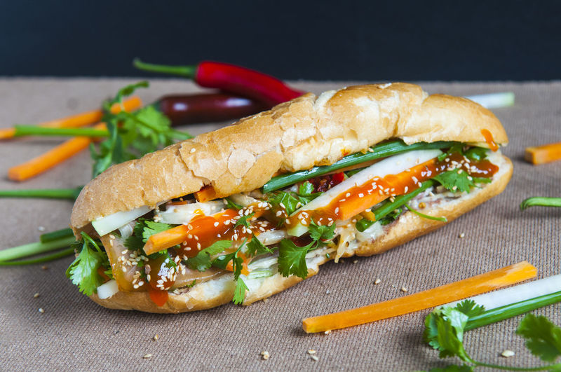 Close-Up Of Sandwich And Vegetables On Table