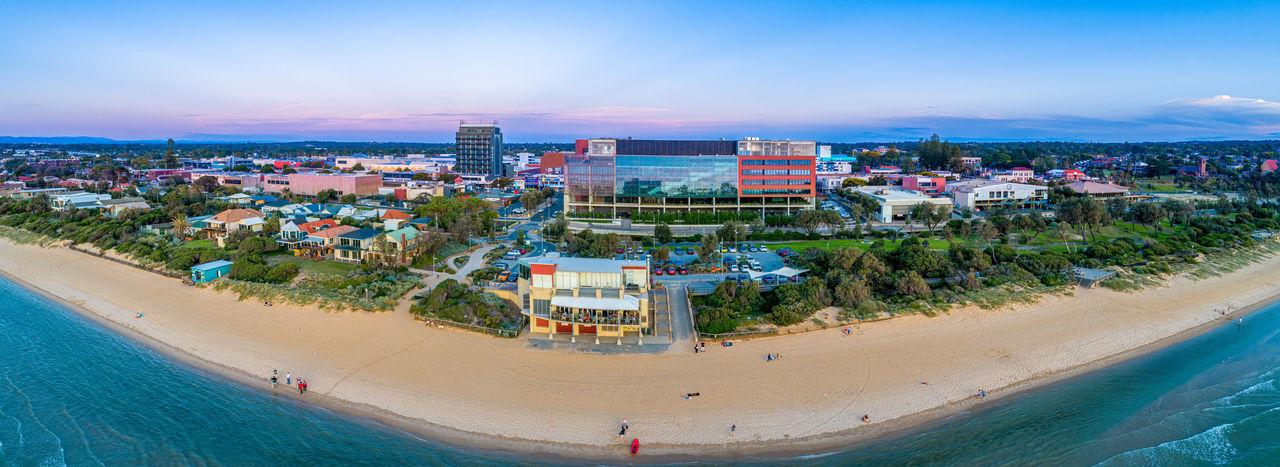 High angle view of beach and buildings against sky