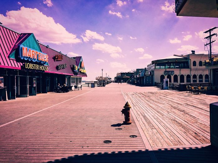 Sky Real People Architecture One Person Building Exterior Built Structure Cloud - Sky Full Length Walking Outdoors Day Lifestyles City Travel Destinations Adult People Beach Boardwalk New Jersey