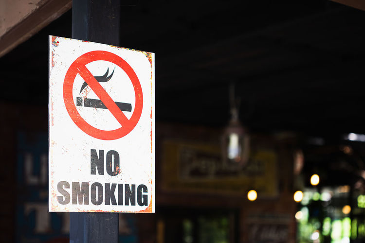 Close-up of no smoking sign outdoors