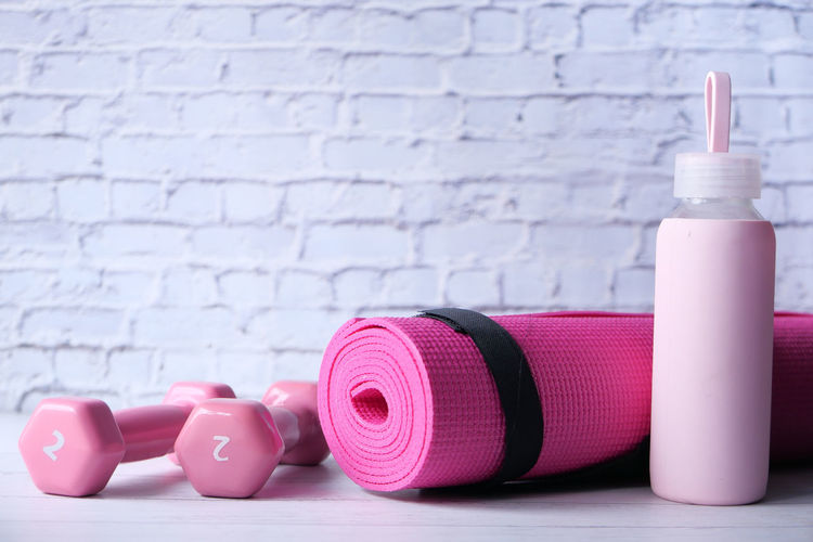 Close-up of pink toys on table against wall