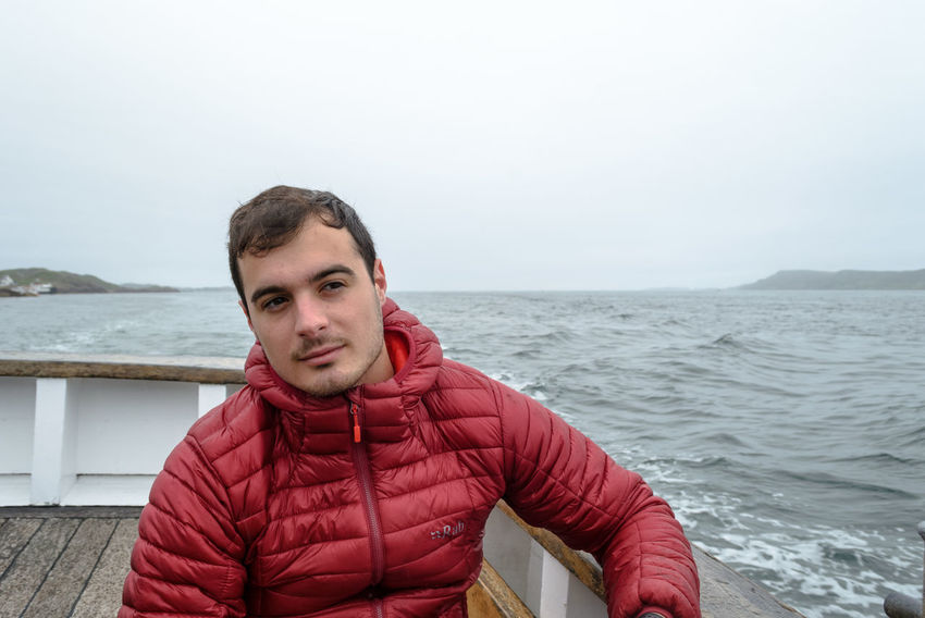 A friend of mine on the boat that took us to Staffa island Excursion EyEmNewHere Foggy Weather Rain Red Seawolf Beauty In Nature Boat Excursion Boat Friend Horizon Over Sea Horizon Over Water Leisure Activity Lifestyles Looking Far Nature One Person Outdoors People Portrait Real People Sea Sea And Sky Sky Water Perspectives On Nature