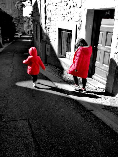 Red Walking Lifestyles Street Person Isolated Color Innocence Colour Of Life Children's Portraits Children Photography Villeneuve-lez-avignon Eyeemphoto Contrasting Colors