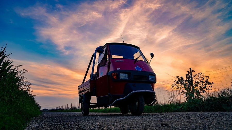 Sky Sunset Transportation Cloud - Sky Land Vehicle Mode Of Transport Field Outdoors Road No People Nature Stationary Landscape Rural Scene Tree Day Ape Piaggio Apecross Low Angle View Close-up Lightroom Mobile The Week On EyeEm Mix Yourself A Good Time