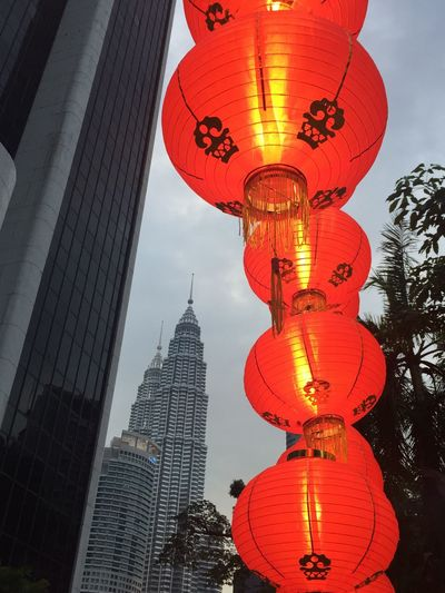 Low Angle View Of Illuminated Lanterns In City Against Sky