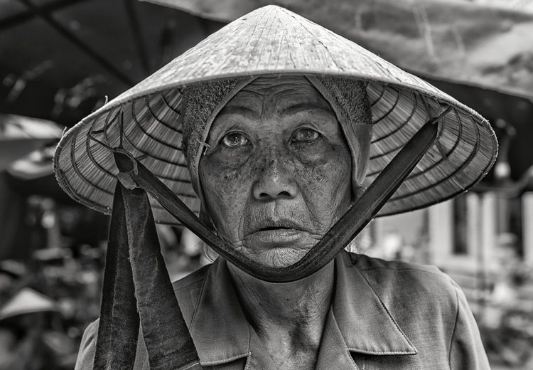 Portrait Of Senior Woman Wearing Asian Style Conical Hat