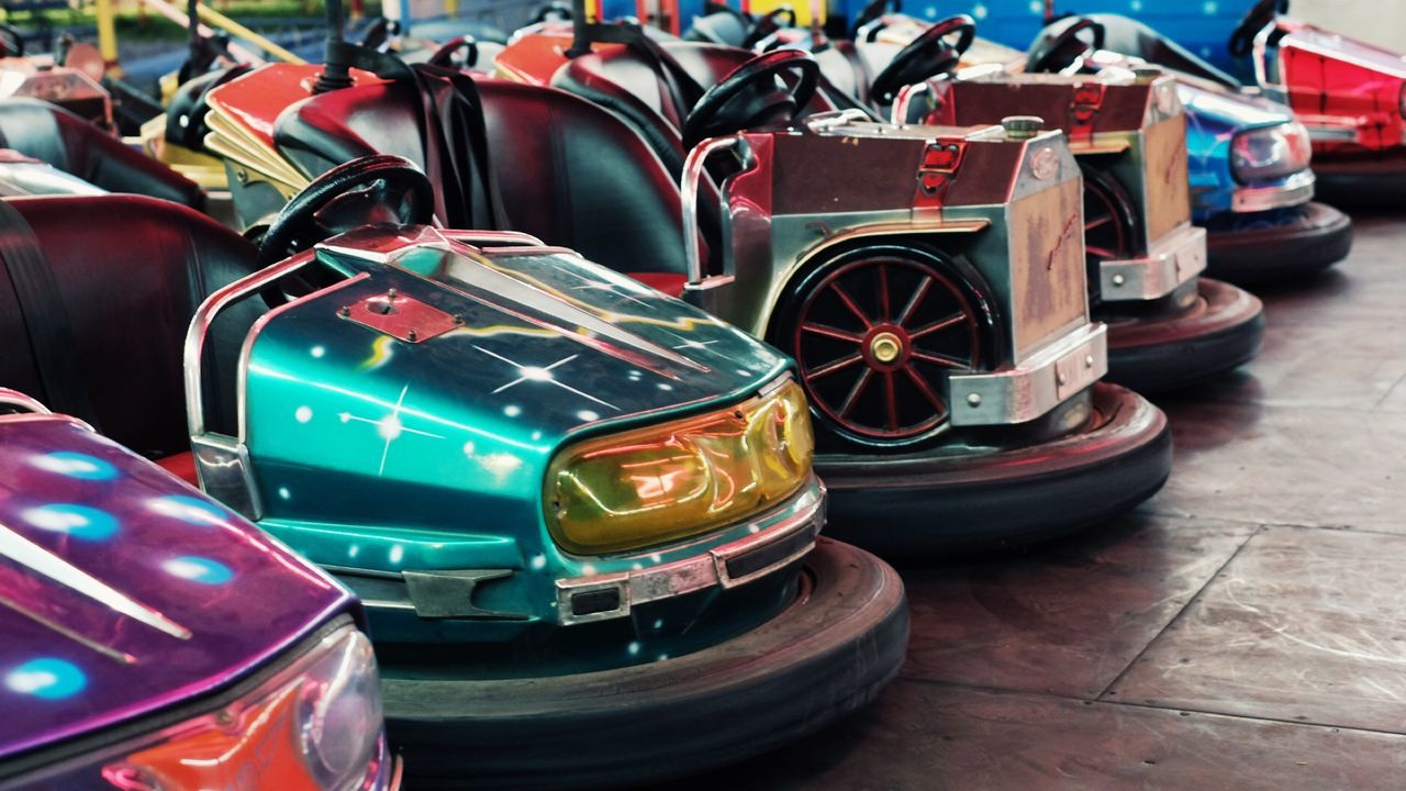 car, mode of transportation, motor vehicle, transportation, land vehicle, toy car, still life, day, no people, toy, high angle view, in a row, variation, stack, choice, close-up, multi colored, outdoors, large group of objects, wheel