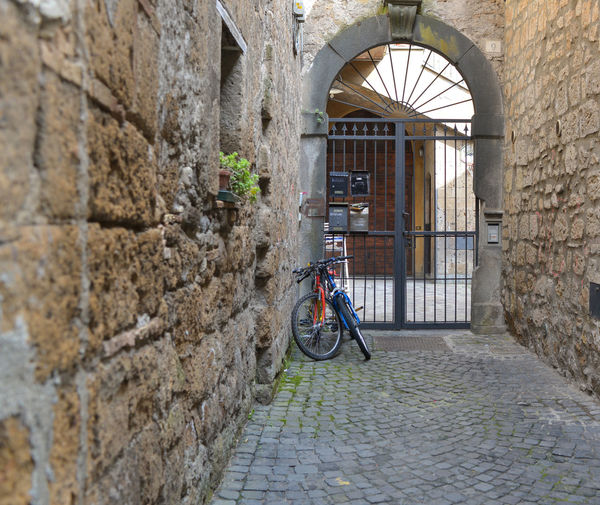 Alley Architecture Bicycle Brick Wall Building Exterior Italy Orvieto, Italy Residential Building Travel