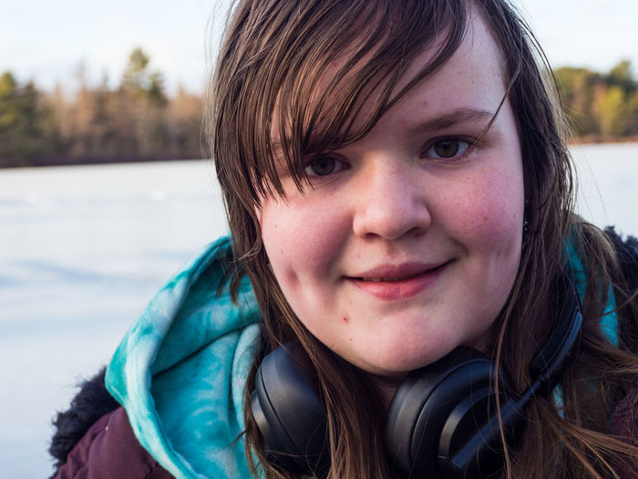 Winter in Nova Scotia. Portrait Headshot Child Childhood One Person Smiling Looking At Camera Front View Close-up Focus On Foreground Real People Day Innocence Happiness Girls Leisure Activity Cute Females Hairstyle Hair Outdoors Bangs Warm Clothing Human Face