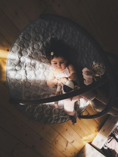 High angle view of cute girl on floor at home