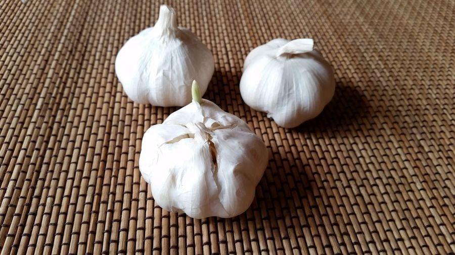 Close-Up Of Garlic On Place Mat