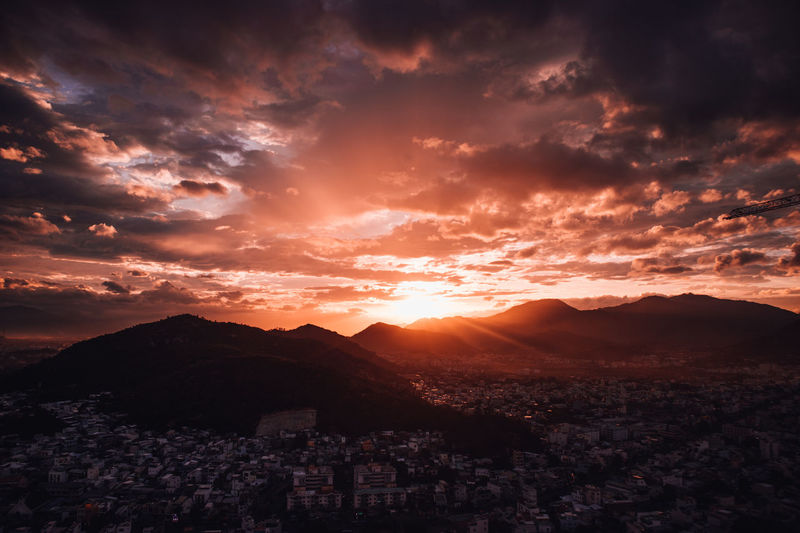Nha Trang cityview on sunset Architecture Beauty In Nature Bright Building Exterior City Cityscape Cloud - Sky Environment Landscape Mountain Mountain Range Nature No People Orange Color Outdoors Scenics - Nature Sky Sun Sunlight Sunset Tranquil Scene Tranquility