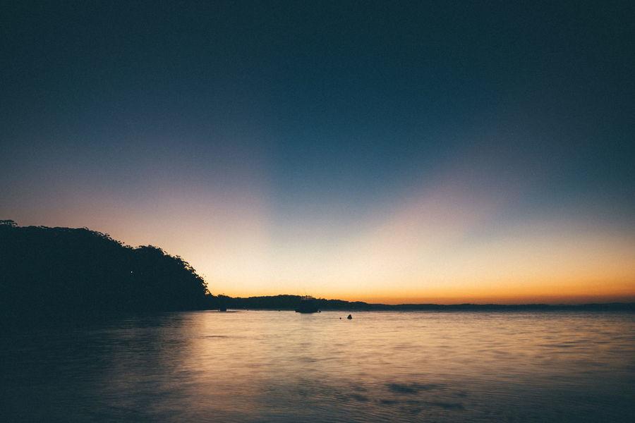 Australia Beauty In Nature Blue Calm Dark Glow Golden Hour Idyllic Majestic Nature No People Non Urban Scene Non-urban Scene Ocean Orange Color Outdoors Remote Scenics Sky Sunset Tranquil Scene Tranquility Vignette Water Waterfront