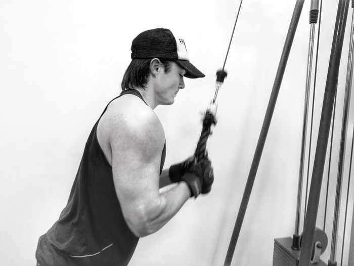 Side View Of Man Exercising At Gym