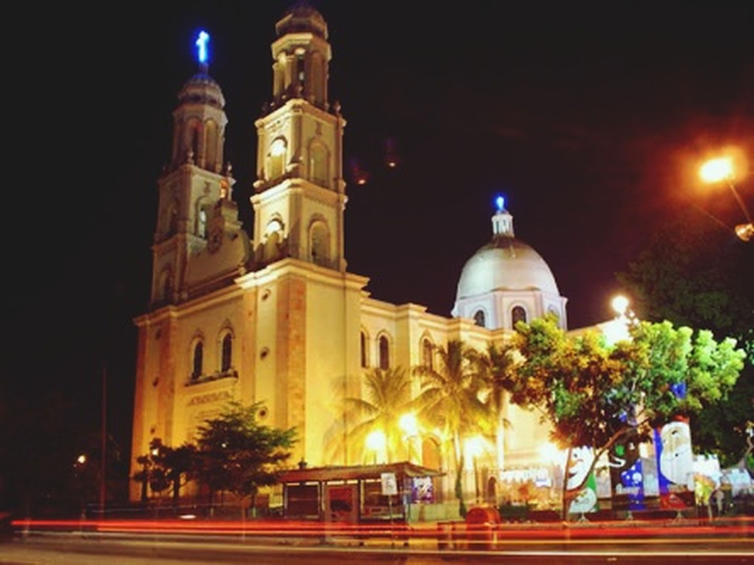 illuminated, religion, night, place of worship, building exterior, built structure, architecture, spirituality, church, dome, street light, lighting equipment, low angle view, clear sky, cathedral, outdoors, sky, no people