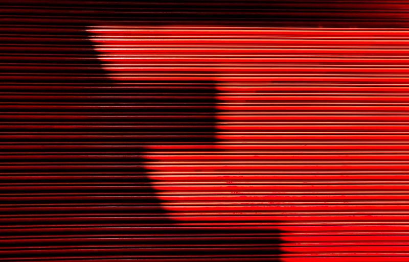 Full frame shot of closed red shutter