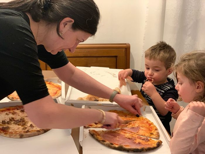 Pizza Time Pizza Eating EyeEm Selects Child Childhood Family Males  Offspring Father Females Food Boys Women Parent Men Girls Togetherness Food And Drink Group Of People Indoors  Lifestyles Daughter