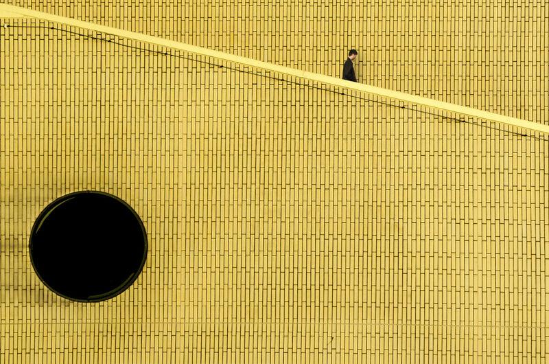 Man seen through blinds