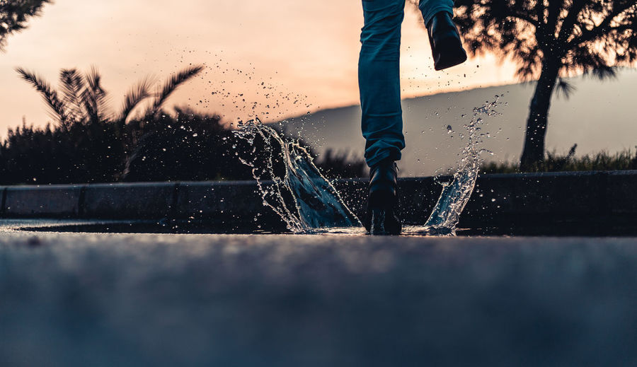 joyful morning One Person Real People Low Section Water Nature Human Leg Lifestyles Leisure Activity Sky Human Body Part Body Part Standing Sunset Motion Plant Day Tree Outdoors Jeans Human Foot