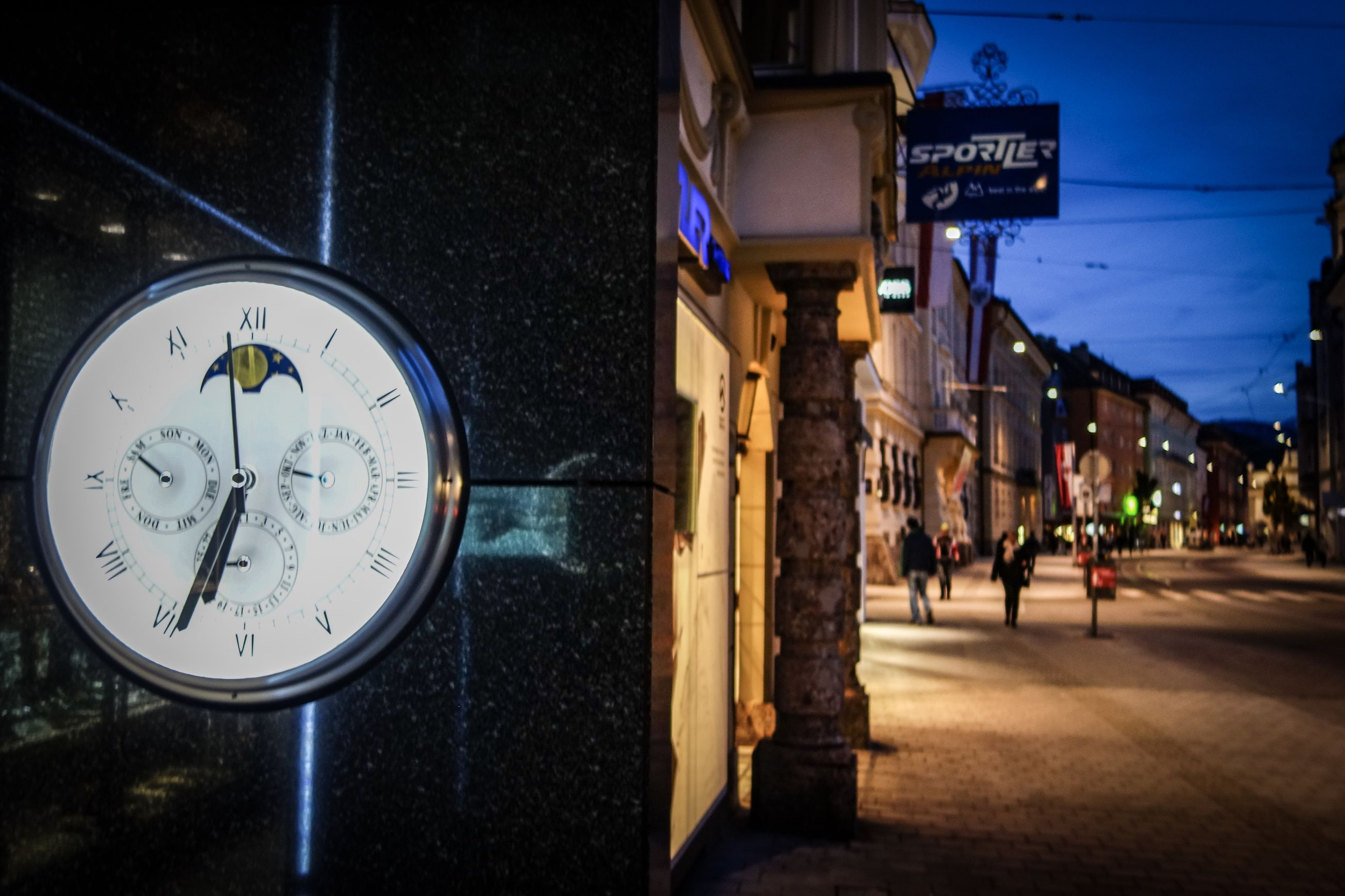 time, architecture, illuminated, clock, communication, built structure, city, building exterior, night, text, sign, street, number, information, footpath, information sign, outdoors, transportation, focus on foreground, direction, clock face