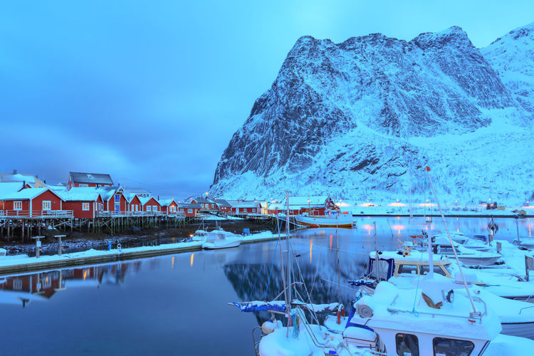 Boats moored in lake during winter