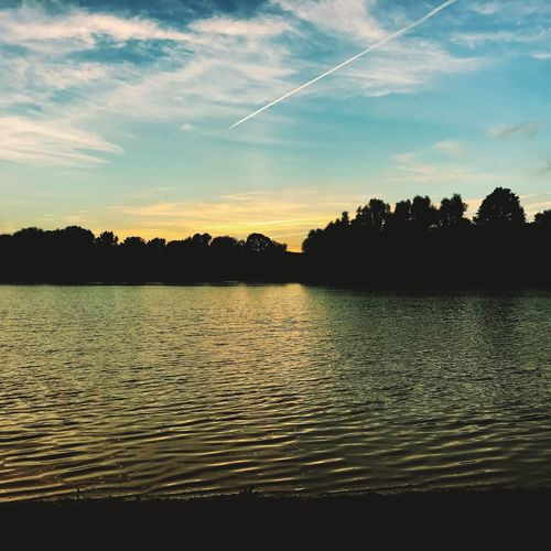 Fühlingersee. Sunset Water Nature Silhouette Beauty In Nature Tranquility Tranquil Scene Lake No People Outdoors Plain Trails Lights And Shadows Köln