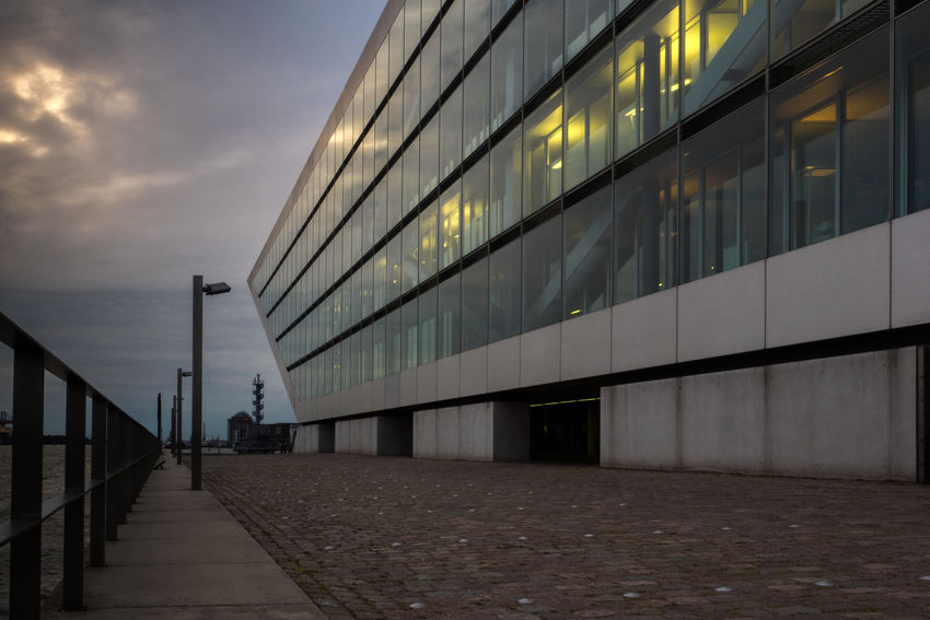 Architecture Building Exterior Built Structure Day Dockland Modern One Person Outdoors People Railing Real People Sky