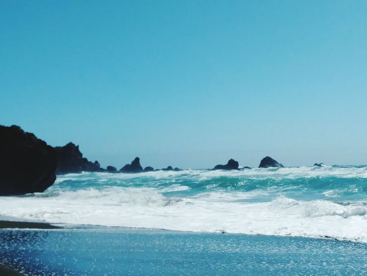 Sea Beach Rock - Object Nature No People Beauty In Nature Outdoors Travel Destinations Wave Blue Sea Life Day Water Scenics Sky Ocean Tide Returning CaliLife California Coast California Love Horizon Over Water Clear Sky Power In Nature Sunny Tide Coming In