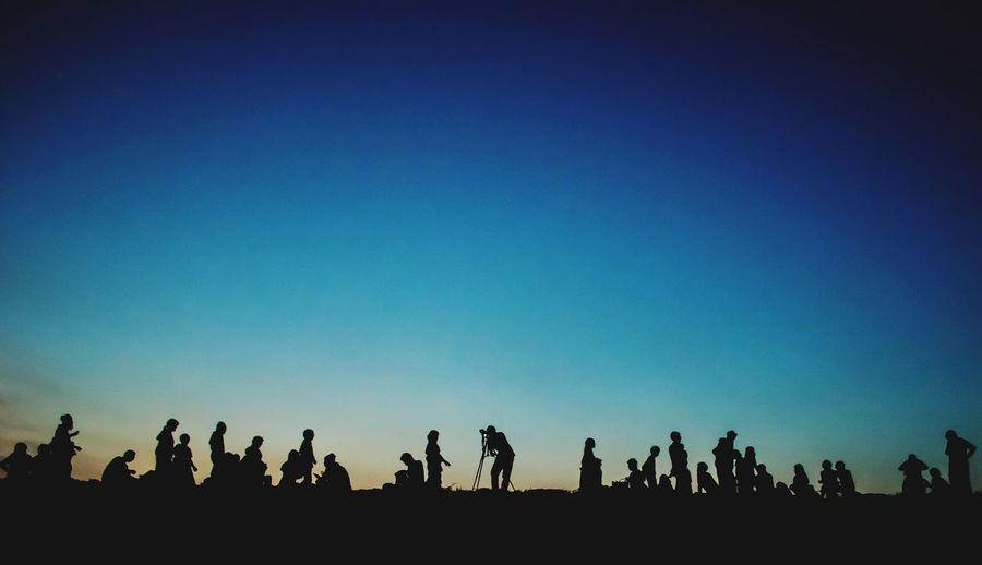 Silhouette People On Field Against Clear Sky During Sunset