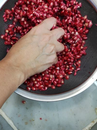Grenadine Pommegranate Juice Human Hand Red Fruit High Angle View Close-up Berry Fruit