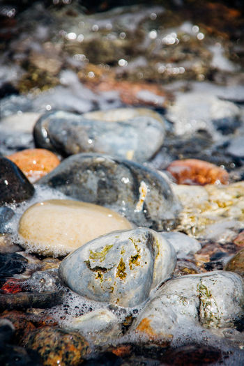 At Ground Level Beauty In Nature Focus On Foreground Geology Large Group Of Objects Pebbles Pebbles And Stones Pebbles And Water Rock Rushing Water Sea Shore Tidal Tide Water Water Surface Wave