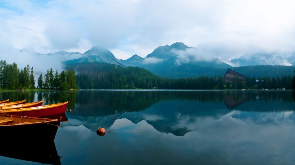 Moment of silence Reflection Lake Mountain Water Tranquil Scene Tranquility Nature Scenics Outdoors Beauty In Nature No People Nautical Vessel Cloud - Sky Mountain Range