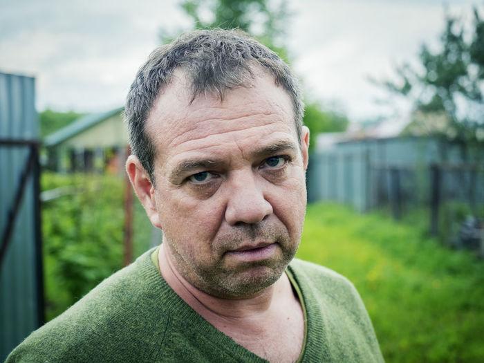 Close-up portrait of serious mature man