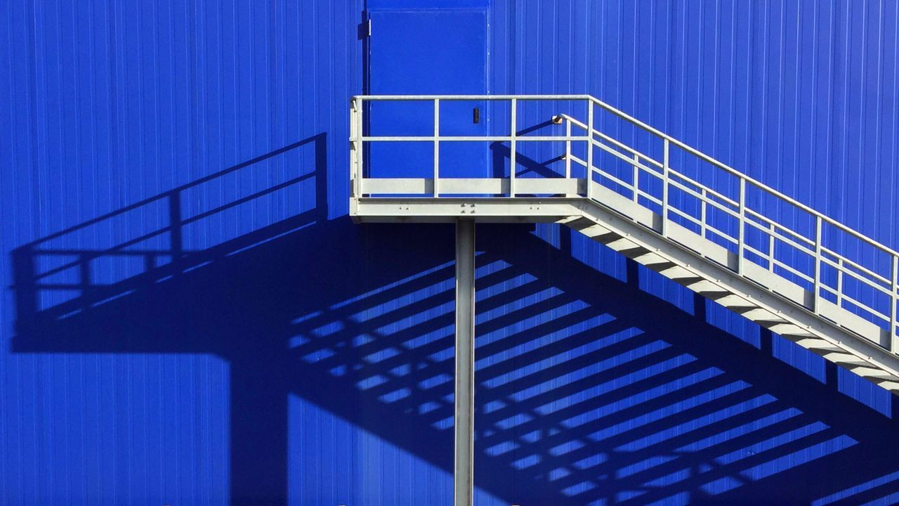 railing, staircase, steps and staircases, built structure, architecture, steps, blue, no people, day, outdoors, building exterior, hand rail