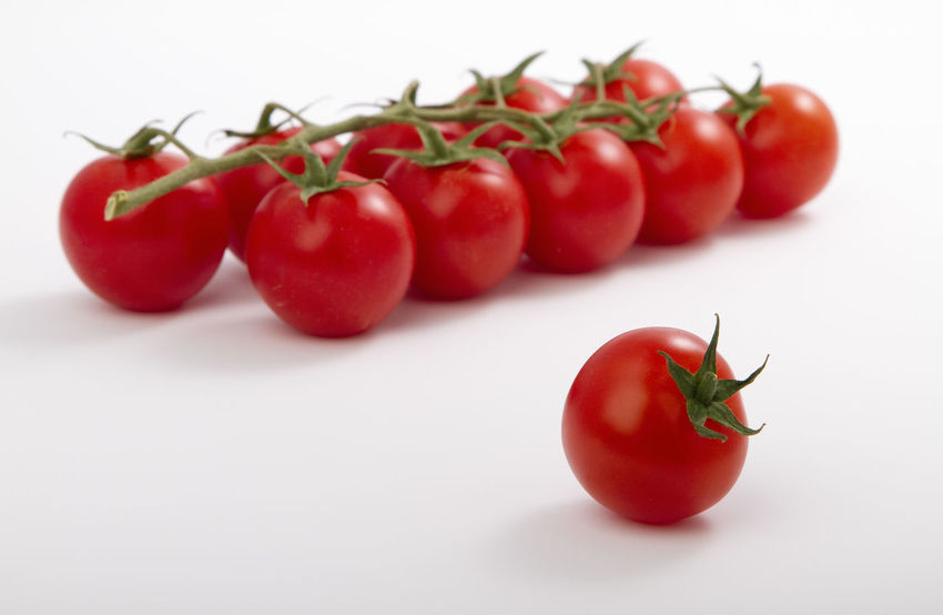 ripe cherry tomatoes on a branch, isolated on white. Cherry Tomato Cherry; Food; Red; Vegetable; Tomato; Healthy; Freshness; Close-up; Objects; Group; Ingredient; Green; Raw; Ripe; White; Organic; Macro; Isolated; Vegetarian; Small; Shiny; Branch; Drop; Wet; Nature; Agriculture; Bunch; Sweet; Plant Close-up Food Food And Drink Freshness Fruit Healthy Eating Indoors  No People Ready-to-eat Red Ripe Studio Shot Tomato Vegetable White Background