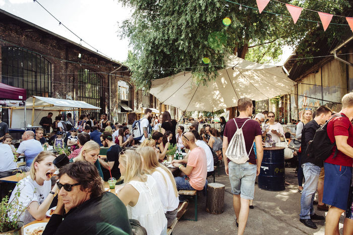 Neue Heimat - Paleo Food Market Berlin Street Markets Berliner Ansichten Day Eating Food Fun Leisure Activity Lifestyles Market Men People Protection Real People Sitting Standing Street Streetfood Streetphotography Togetherness Tradition Umbrella Women