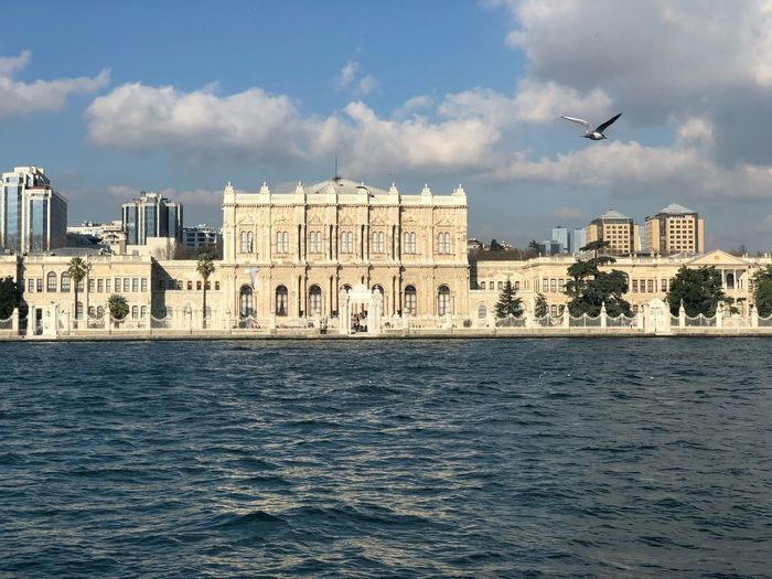 Dolmabahçe palace EyeEm Nature Lover EyeEmNewHere Sea Ocean Istanbul Turkey Castle Palace Photograph Cityscape Sightseeing Building Exterior Water Architecture Sky Built Structure Waterfront Cloud - Sky Flying Bird Nature Day Building City Sea Outdoors No People