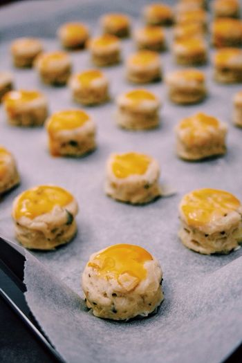 High angle view of mini scones on baking sheet