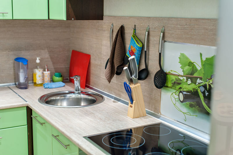 Domestic Kitchen Kitchen Home Domestic Room Household Equipment Indoors  No People Sink Kitchen Counter Kitchen Utensil Wood - Material Home Interior Kitchen Sink Kitchen Knife Still Life Faucet Container Potted Plant Cutting Board Table Table Knife