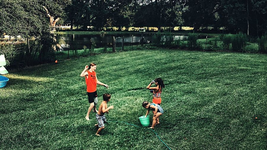 People Together My Kids Taking Advantage Of Natures Beauty Family That Plays Together Stays Together Getting Wet Cooling Down Children Photography Candid Photography Alabama Hwy. 90 Mobile County Country Life Everyday Emotion Sprinkler In Grass Throwing Water Balloons Beating The Heat Impromptu Play July 2016 From My Point Of View Friendship Family Crazy Kids Messy Moments Are The Most Memorable Having Such A BLAST!!