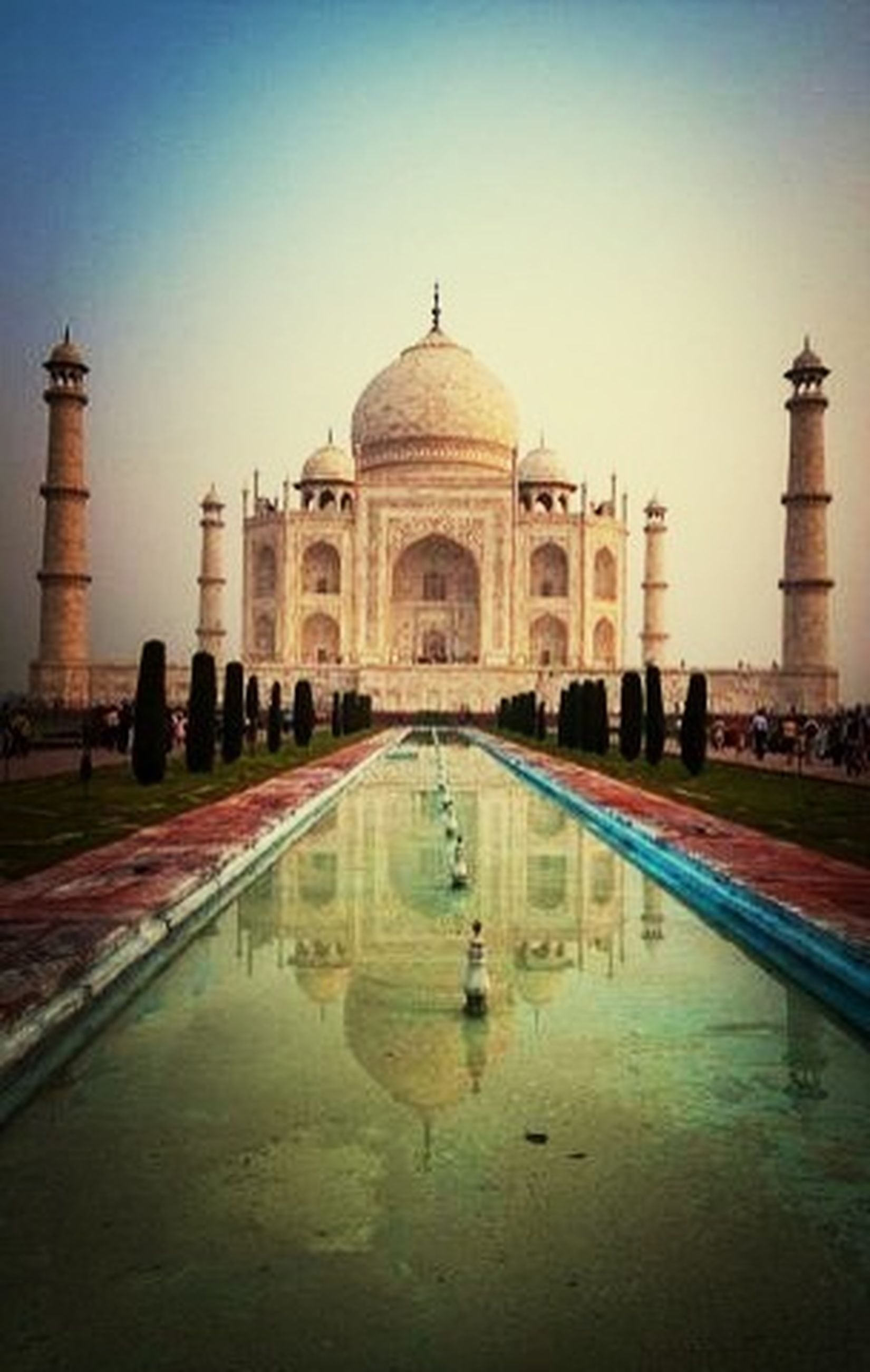 architecture, built structure, famous place, dome, travel destinations, international landmark, tourism, building exterior, travel, arch, water, history, clear sky, religion, place of worship, capital cities, islam, incidental people, taj mahal