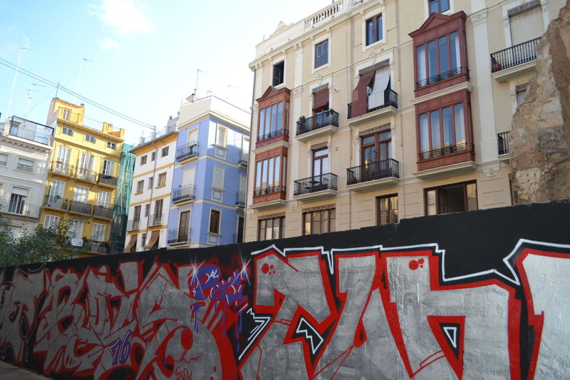 Architecture Architecture Building Building Exterior Built Structure City City City Life Day Low Angle View No People Outdoors Red Residential Building Sky Skyline Streetart/graffiti StreetArtEverywhere Streetphotography Valencia, Spain Window