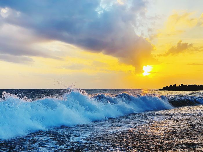 Cloud - Sky Sky Water Sea Sunset Beauty In Nature Cloud - Sky Scenics - Nature Horizon Over Water No People Nature Motion Wave Power In Nature Beach Splashing Land Horizon Breaking Orange Color Power