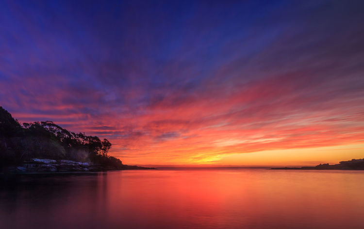 sometimes the best screensavers are offline Vivid Colours  Sunset Landscape_photography Colorful Colorful Sky Romantic Sky Reflection Lake Seascape Atmospheric Mood Calm Coastal Feature Moody Sky Ocean Dramatic Landscape Reflecting Pool Coastline Majestic
