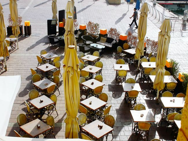 Beautifully Organized High Angle View Popular Eyeemphoto Check This Out! From My Point Of View The Week On Eyem Eyeem Gallary Popular Photos What Who Where Restaurant Scene Restaurant Tables Tables And Chairs Restaurant Outdoor Umbrellas Orange Color The City Light