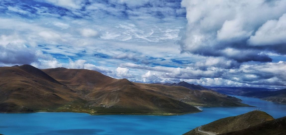 Water Scenics Mountain Tranquil Scene Beauty In Nature Cloud - Sky Tranquility Nature Sea River Atmospheric Mood Sky Cloudscape Mountain Range Non-urban Scene Cumulus Cloud Majestic Dramatic Sky Day Tourism