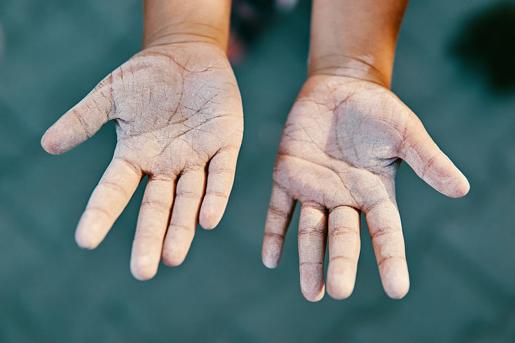 Chalky hands of a child after creating art on a sidewalk Fun Bokeh Chalk Child Childhood Close-up Dirt Dirty Finger Focus On Foreground Hand Human Hand Human Skin Skin