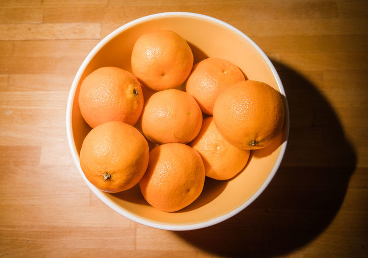 Clementines in a bowl on a wooden counter. Bowl Citrus Fruit Clementines Close-up Countryside Food Freshness Fruit Healthy Eating Holding No People Orange - Fruit Orange Color Tangerine