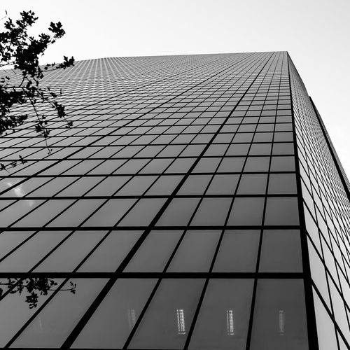 Architecture Black & White Black And White Blackandwhite Built Structure EyeEm Eyeemblack&white Fassade From Below From My Point Of View Full Frame IPhoneography Low Angle View Modern Pattern Repetition Skyscraper Structure To The Sky To The Top Windows Learn & Shoot: Leading Lines