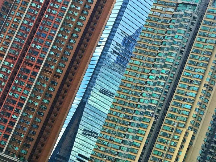 Urban living Densely Populated Outdoors Askew Residential Buildings Travel Destinations City Urban Skyline Hong Kong Full Frame Backgrounds No People Pattern High Angle View Text Architecture Built Structure In A Row A New Perspective On Life 17.62° The Architect - 2019 EyeEm Awards